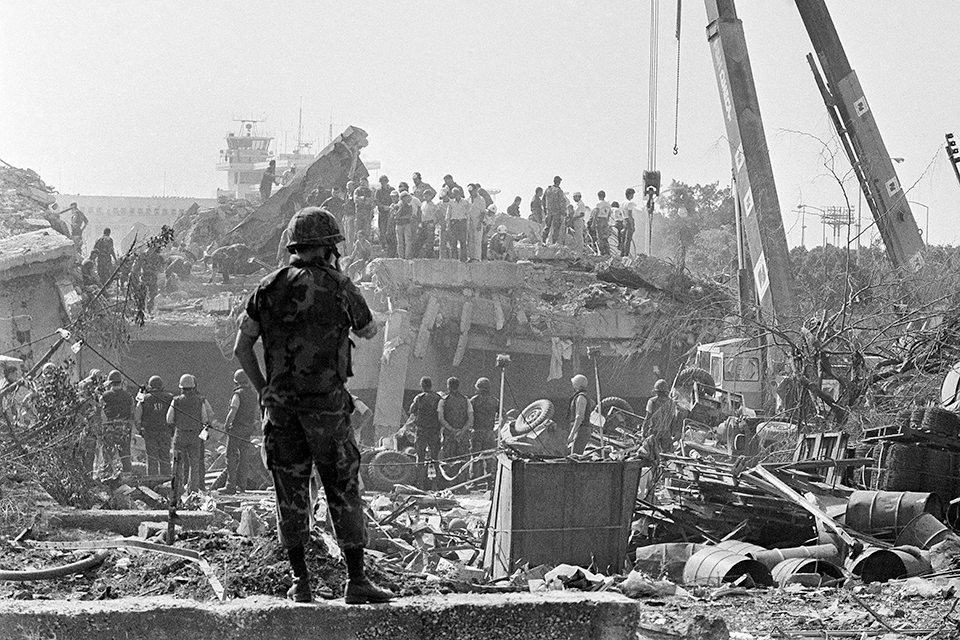 Hours after the Sunday, Oct. 23, 1983, bombing of the Marine barracks in Beirut, rescuers comb the wreckage for the wounded and dead. (Zouki/AP)