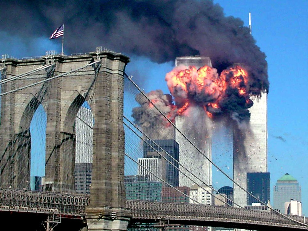 The second World Trade Center tower explodes into flames after being hit by an airplane, New York September 11, 2001, with the Brooklyn Bridge in the foreground.(Sara K. Schwittek/Reuters)