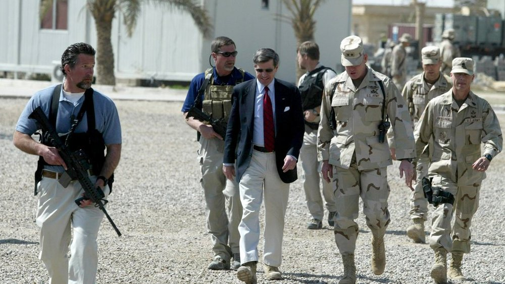 Blackwater personnel escorting Paul Bremer, an American civil administrator, upon his arrival in Ramadi, Iraq, in March 2004. (Peter Andrews/Reuters)