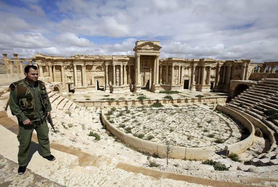 A Syrian policeman patrols the ancient city of Palmyra, which lay at the crossroads of several civilizations. Looting has been a problem at many historical sites. (Joseph Eid/AFP)