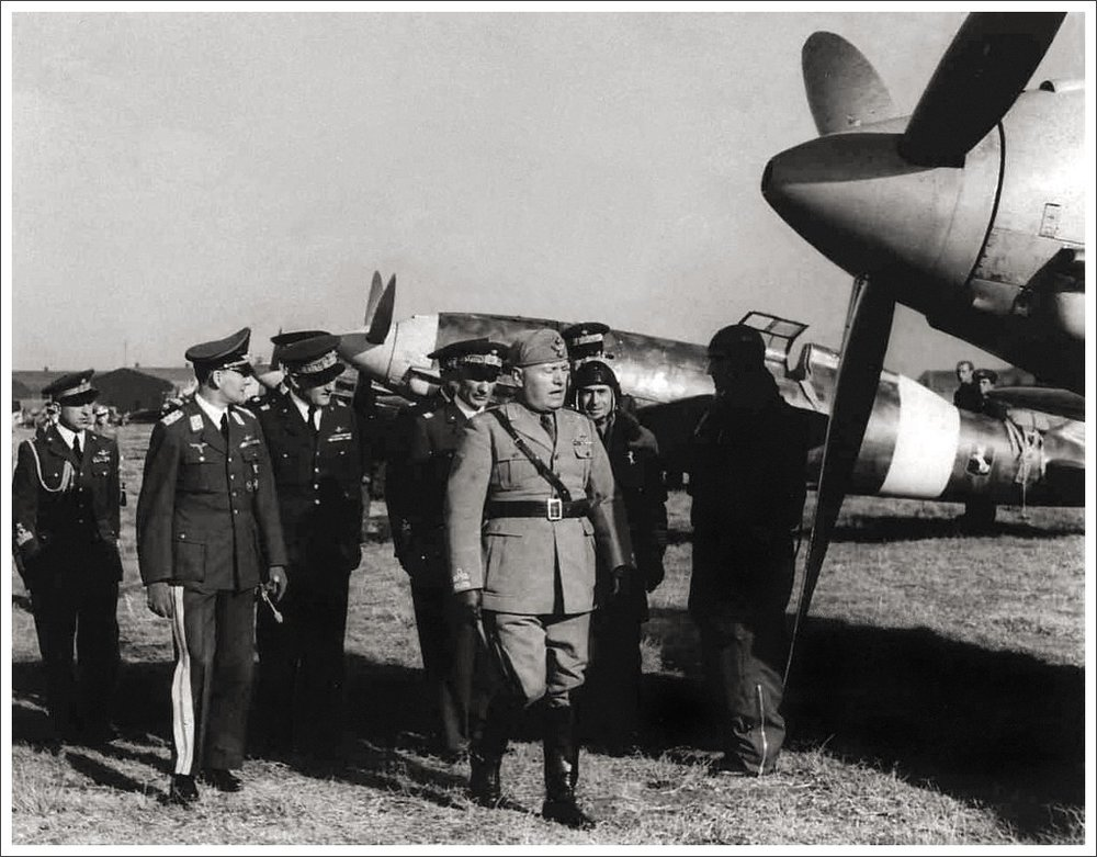 Benito Mussolini reviewing the Macchis C.202 of the IX Fighter Group.