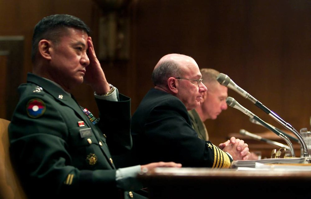 General Eric Shinseki, left, Army Chief of Staff, testifies in February 2003 before the Senate Armed Services Committee on Capitol Hill along with Admiral Vernon Clark and General Michael Haggee of the Marine Corps. (KRT)