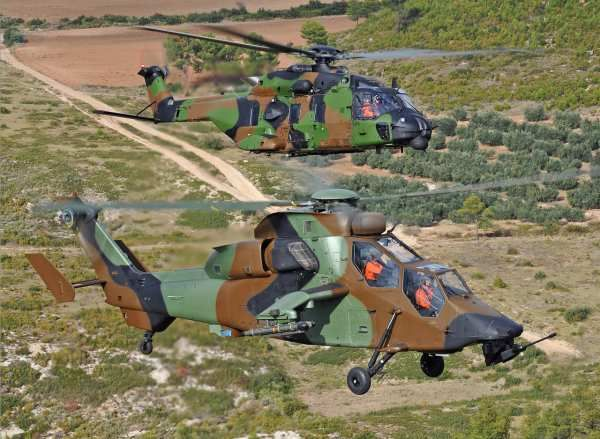 French Armée de Terre Eurocopter EC 665 Tigre attack helicopter escorts a NHIndustries NH 90 TTH (tactical transport helicopter), known as Caiman in French service.