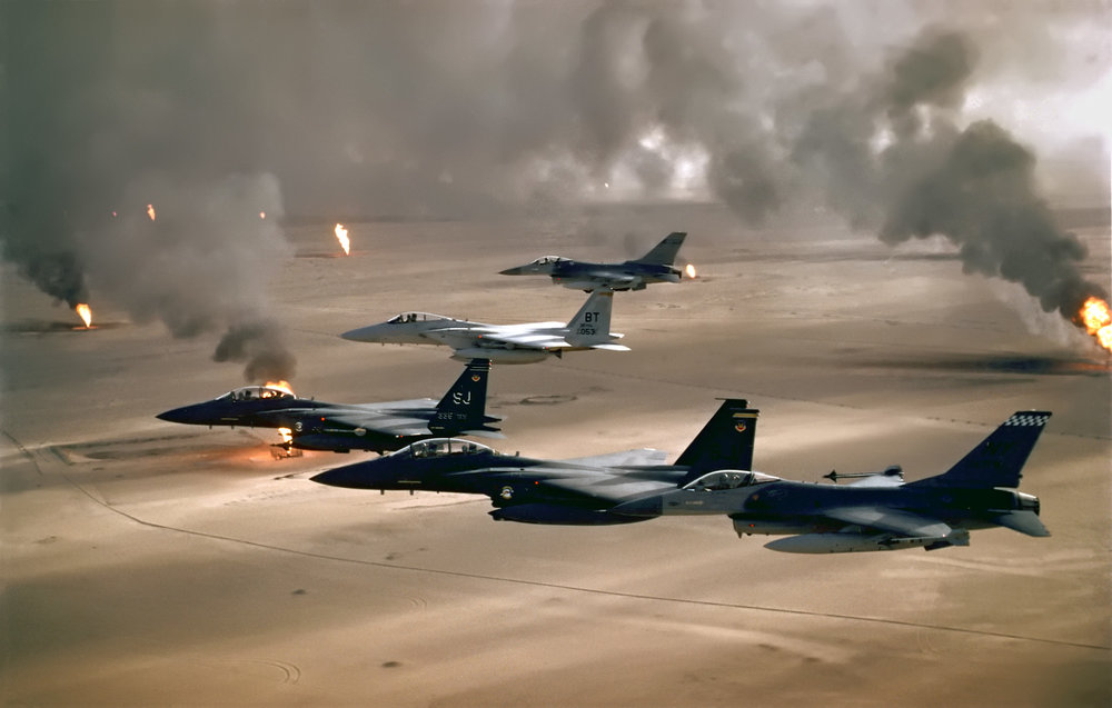 USAF aircraft fly over Kuwaiti oil fires, set by the retreating Iraqi army during Operation Desert Storm in 1991. (USAF Photo/Wikimedia)