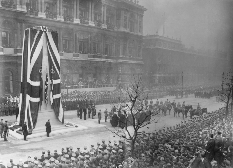 The gun carriage bearing the Unknown Warrior at the Cenotaph on Whitehall for the unveiling ceremony by King George V on 11 November 1920, the second anniversary of the Armistice. The Unknown Warrior was later interred in Westminster Abbey. (Imperial War Musesum)