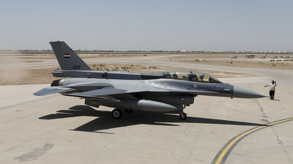 Iraq's Defence Minister Khaled al-Obeidi sits in a F-16, during an official ceremony to receive four aircraft from the U.S. at a military base in Balad, Iraq, July 20, 2015. (Reuters)
