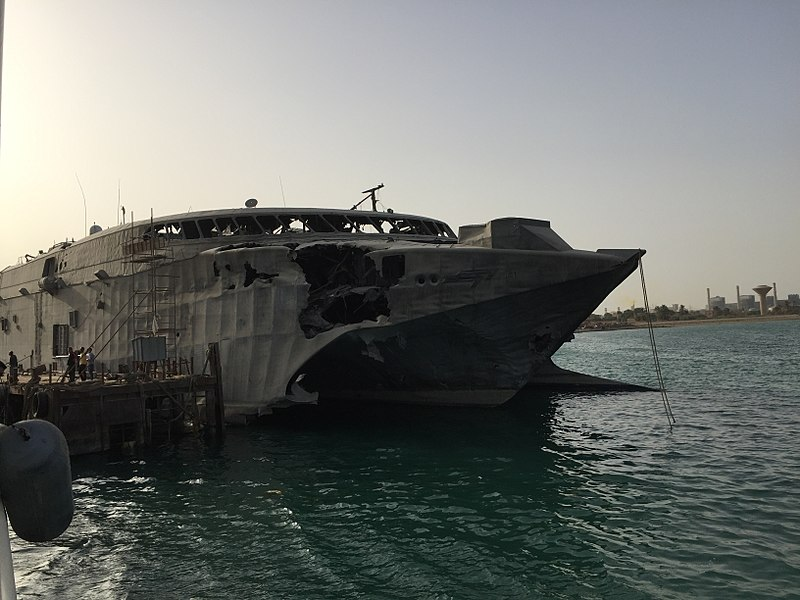 Swift in port at Oceandro Large Yacht shipyard, Port Suez, Egypt. Damage to the starboard bow from the alleged Houthi rebel attack is clearly visible. (Wikimedia)