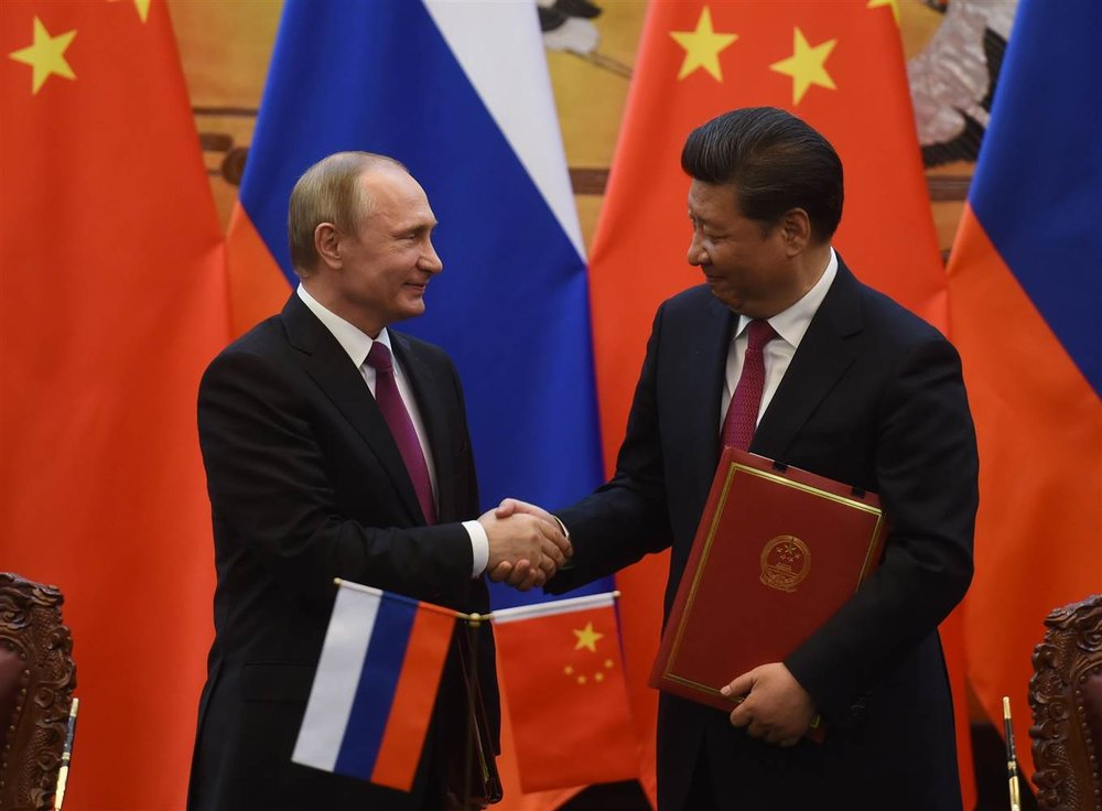 Russian President Vladimir Putin shakes hands with Chinese President Xi Jinping at Beijing's Great Hall of the People in 2016. (Greg Baker/AFP/Getty)