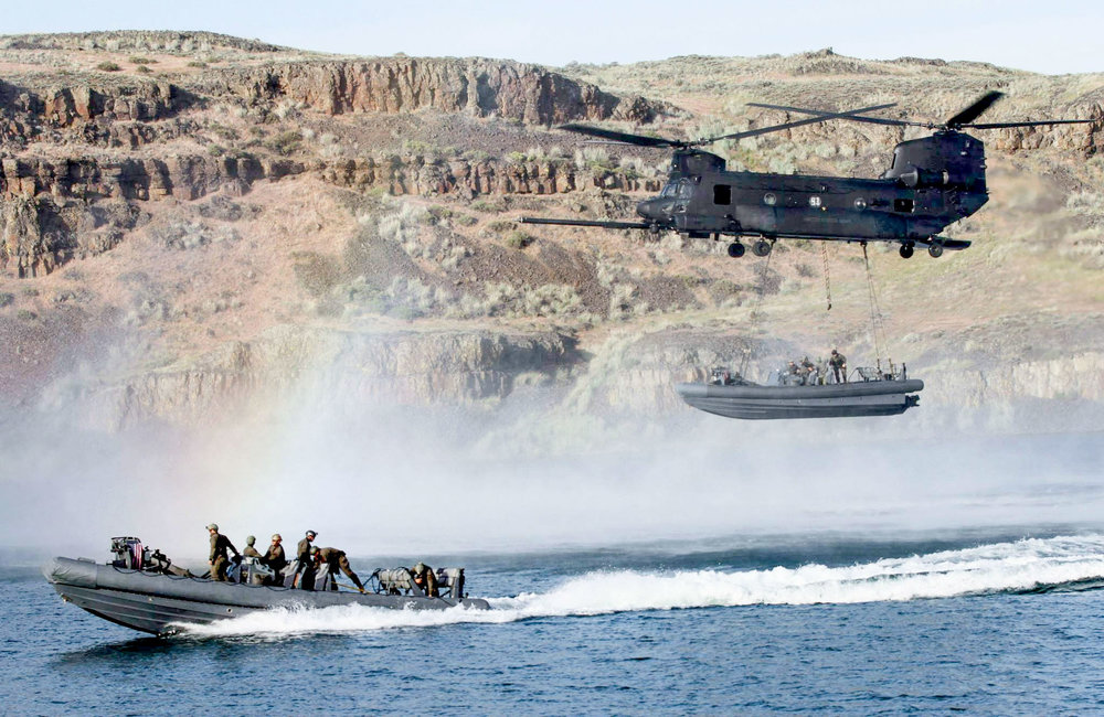 U.S. Navy and Army special operations forces training together in 2014. (Sgt. Christopher Prows/U.S. Army Photo)