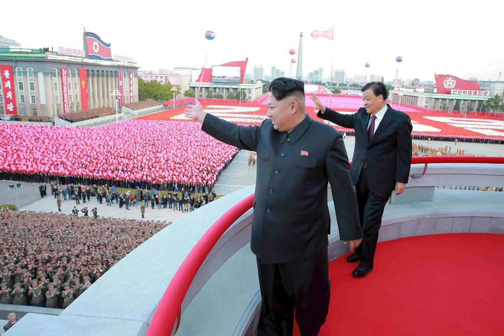 The North Korean leader Kim Jong-un with Liu Yunshan, a Chinese official, at a military parade in Pyongyang in 2015 | Korean Central News Agency.