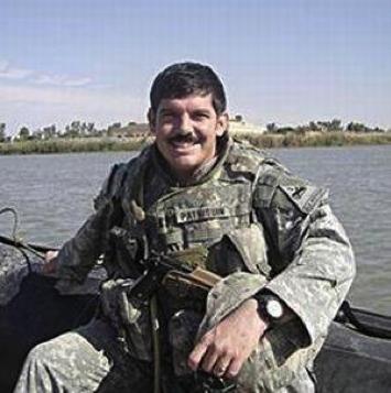Captain Travis Patriquin on the Euphrates River near Ramadi