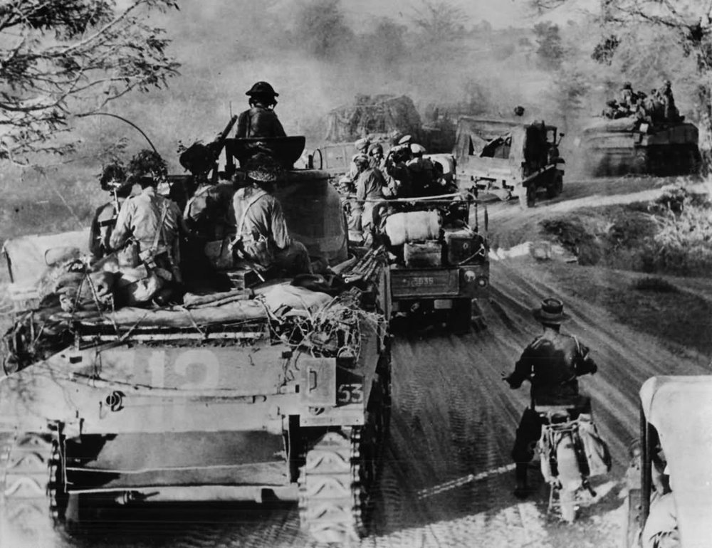 British M4 Sherman tanks and infantry advance to Meiktila Burma