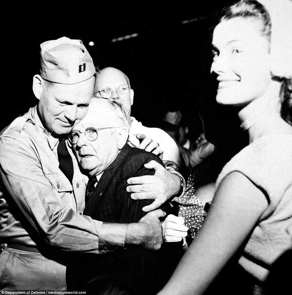 Repatriated POW Capt. Frederick Smith is greeted by his father on his arrival at Fort Mason, California, on board the USNS Marine Phoenix, September 14, 1953.