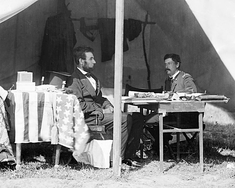 Abraham Lincoln and George B. McClellan in the general's tent at Antietam, Maryland, October 3, 1862. (Wikimedia)
