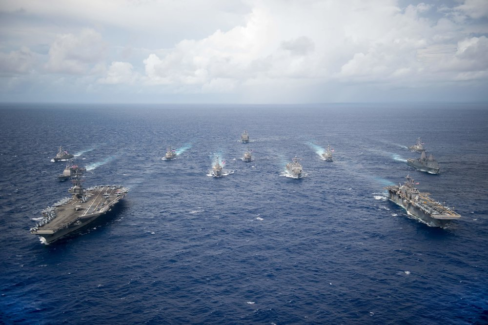 PHILIPPINE SEA (Sept. 23, 2016) USS Ronald Reagan (CVN 76) and USS Bonhomme Richard (LHD 6) lead a formation of Carrier Strike Group Five and Expeditionary Strike Group Seven ships to signify the completion of Valiant Shield 2016. Photo by U.S. Navy photo by Mass Communication Specialist 2nd Class Christian Senyk (Wikimedia)