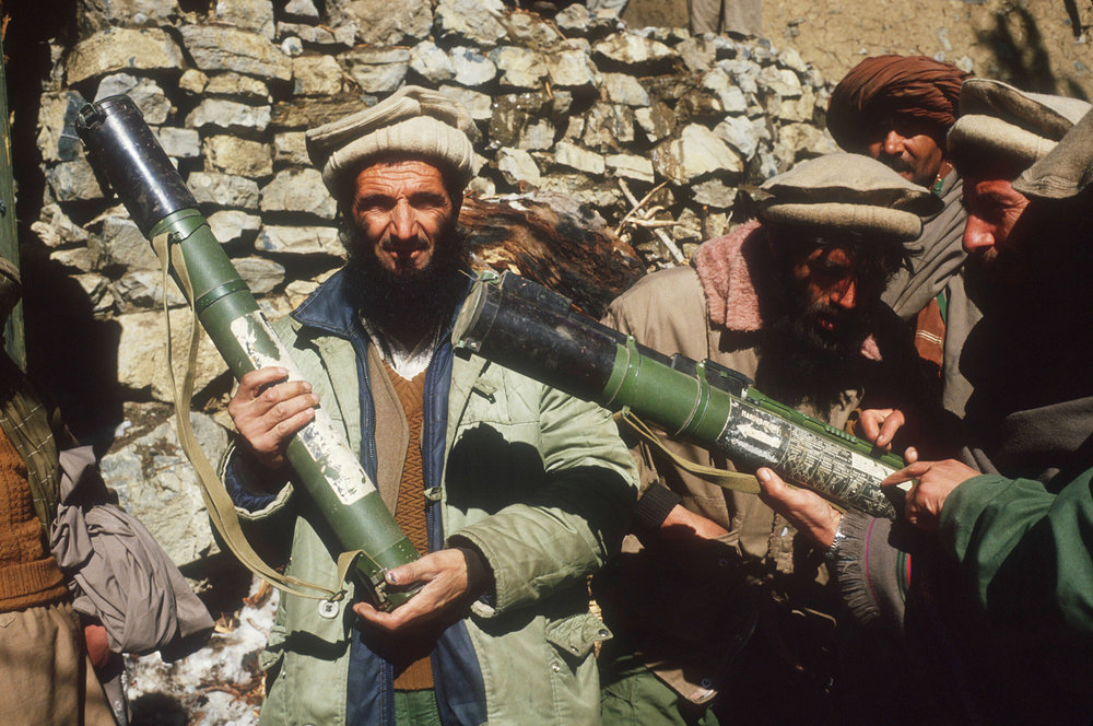 Mujahideen in Afghanistan with smuggled weapons (Getty Images)