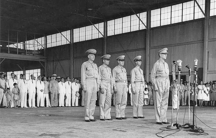 Ceremony at Camp Murphy, Rizal, on 15 August 1941, marking the induction of the Philippine Army Air Corps. Behind Lt. Gen. Douglas MacArthur, from left to right, are Lt. Col. Richard K. Sutherland, Col. Harold H. George, Lt. Col. William F. Marquat, and Maj. LeGrande A. Diller. (Wikimedia)