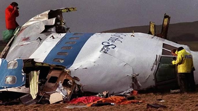 Investigators examine the wreckage of Pan Am Flight 103. (History.com)