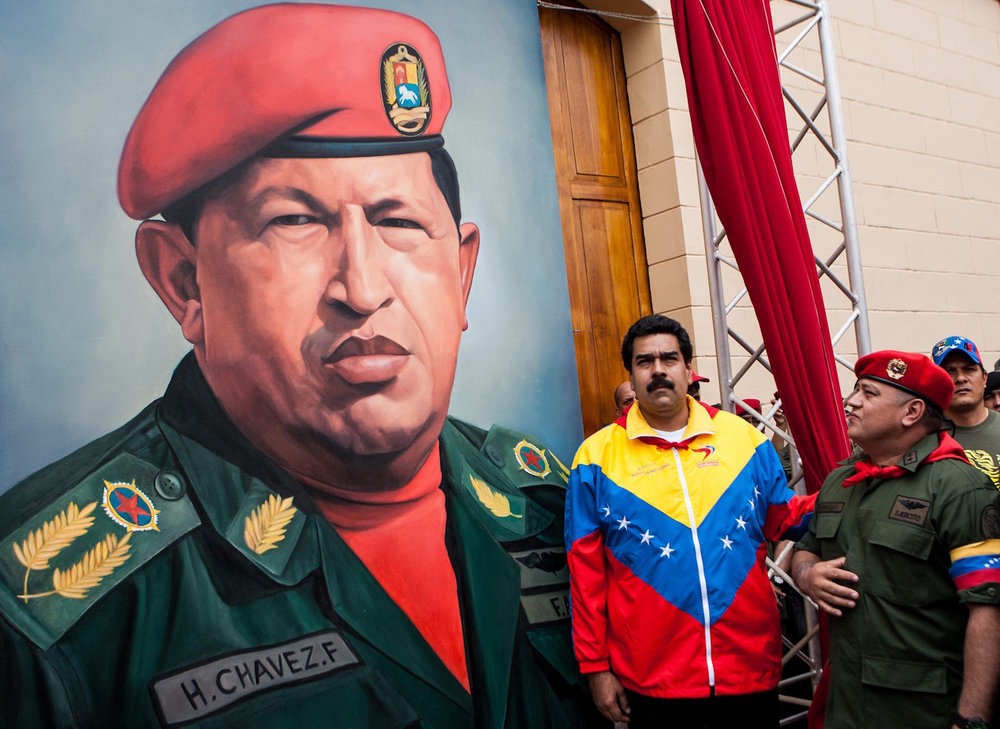 Venezuelan President Nicolas Maduro poses with Socialist Party Vice-President Diosdado Cabello next to a portrait of Hugo Chavez. (Photo by Jorge Silva/Reuters)