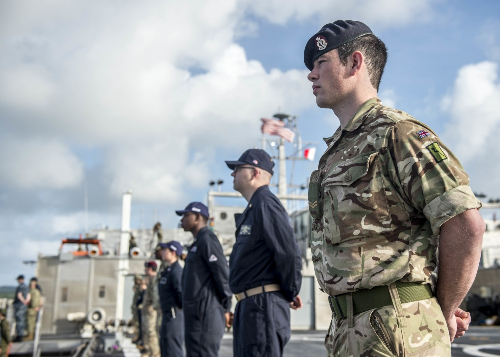 Combined forces aboard the expeditionary fast transport ship USNS Brunswick man the rails as the ship arrives in Colonia, Micronesia, for the first stop of Pacific Partnership 2018. U.S. Navy Photo/Seaman Caledon Rabbipal)