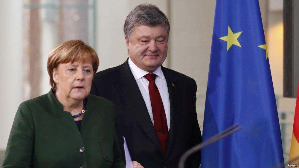 German Chancellor Angela Merkel and Ukrainian President Petro Poroshenko (Radio Free Europe)
