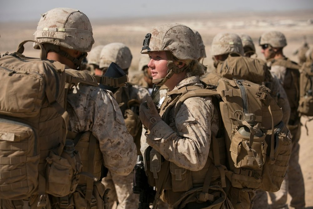 Lance Corporal Callahan Brown talks with a fellow Marine with the Ground Combat Element Integrated Task Force after an infantry assessment at Marine Corps Air Ground Combat Center Twentynine Palms in Twentynine Palms in 2015.(Mike Morones/Marine Corps Times)