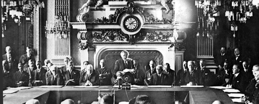 French Foreign Minister Aristide Briand, center standing, gives his address in the Palais D'Orsay, Paris, Aug. 27, 1928, before the signing of the Pact Of Peace by 15 nations. Seated at table, left to right; Paul Haymans, Belgian Foreign Minister; German Foreign Minister Gustav Stresemann; Briand; Frank B. Kellogg, U.S. Secretary of State; Lord Ronald Cushendun, Acting Secretary of State for Foreign Affairs for Britain. (AP)
