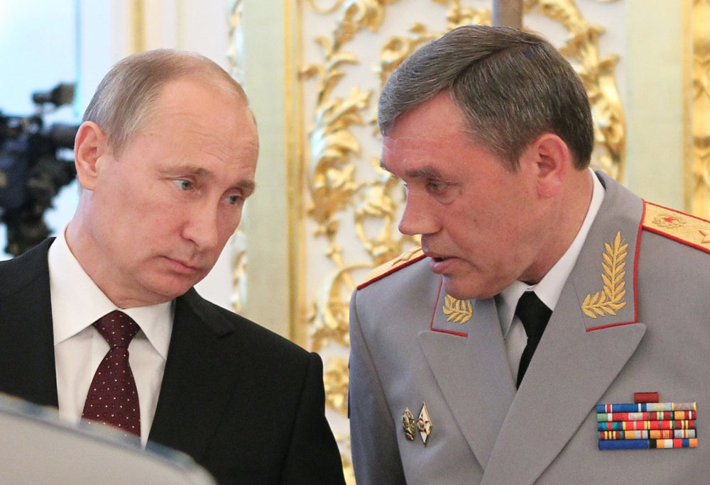 Russian President Vladimir Putin and Chief of the General Staff Gen. Valery Gerasimov (Mikhail Klimentyev/AFP/Getty Images)