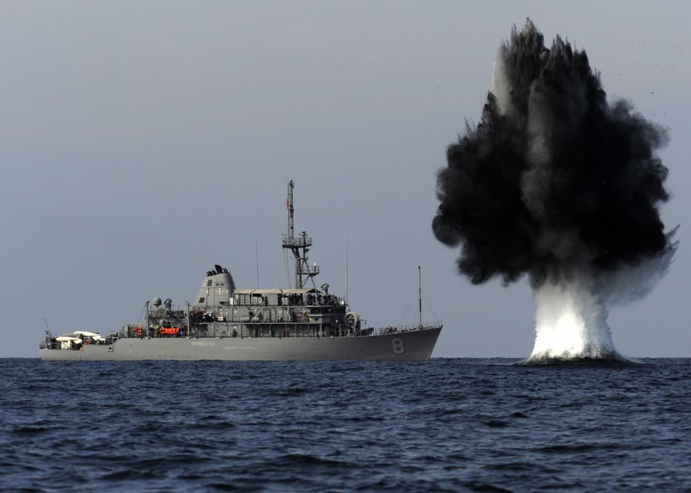 A demolition charge detonates 1,500 meters from the Avenger-class mine countermeasures ship USS Scout. (Mass Communication Specialist 1st Class Joshua Lee Kelsey/U.S. Navy Photo)