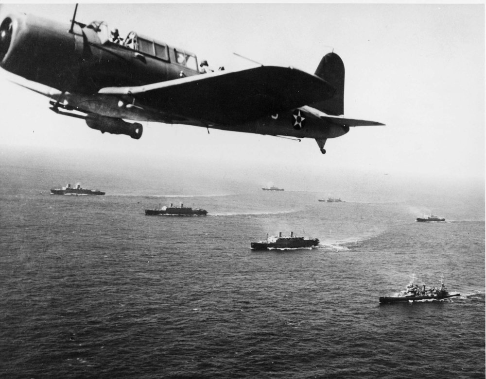A Vought SB2U Vindicator from the USS Ranger flies anti-submarine patrol over Convoy WS12 en route to Cape Town, 27 November 1941. (U.S. Navy Naval History Center/Wikimedia)