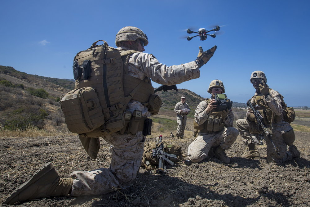 U.S. Marine Lance Cpl. Benjamin Cartwright launches the Instant Eye MK-2 Gen 3 unmanned aerial system during an exercise for Marine Corps Warfighting Laboratory's Marine Air-Ground Task Force Integrated Experiment on Camp Pendleton. (USMC Photo)