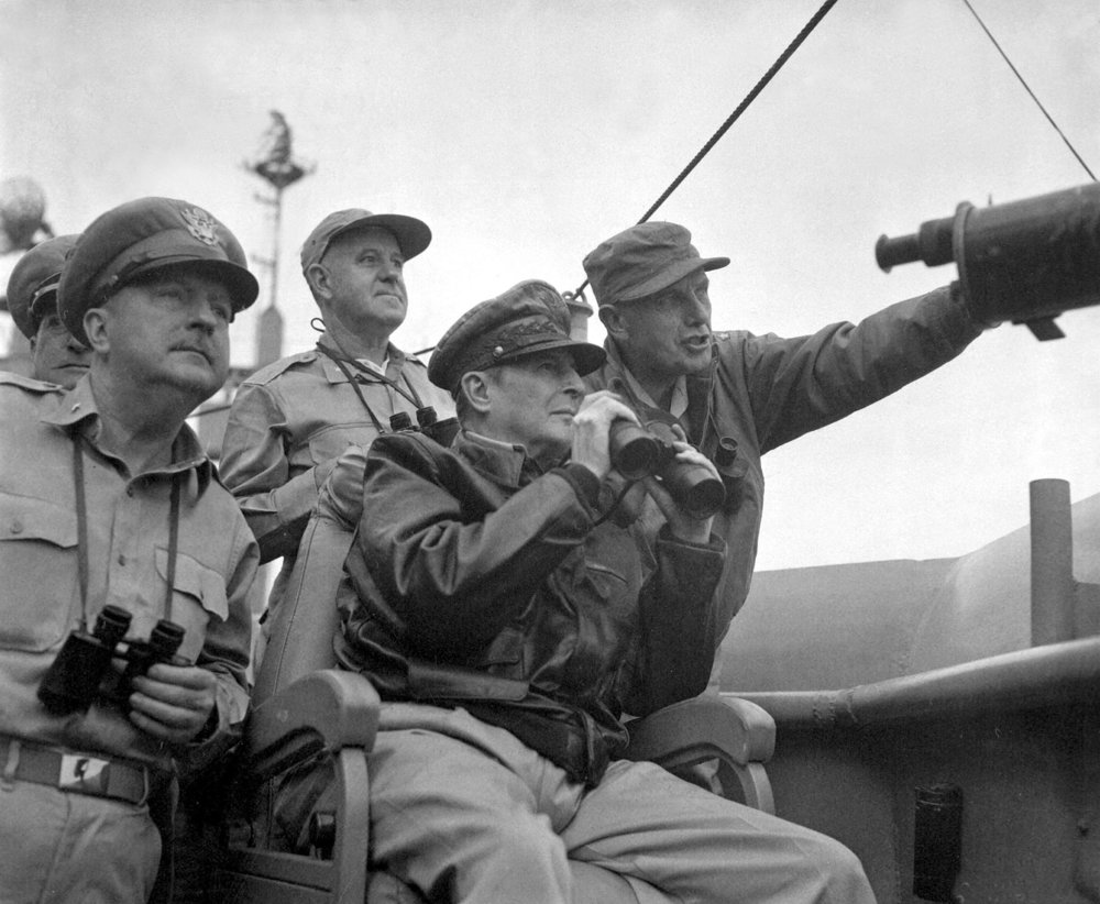 Brigadier General Courtney Whitney, General Douglas MacArthur, and Major General Edward Almond observe the shelling of Incheon from the USS Mount McKinley on 15 September 1950. (U.S. Army Photo/Wikimedia)