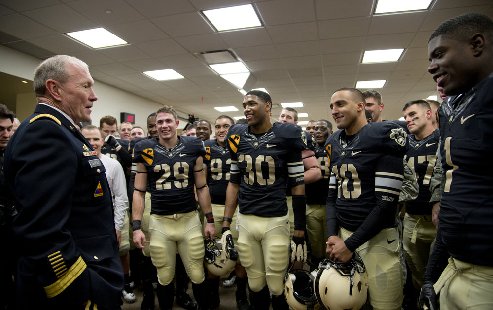 Chairman of the Joint Chiefs of Staff Gen. Martin E. Dempsey speaks with West Point football players in the locker room after their win over Air Force in West Point, N.Y., on Nov. 3, 2012. (TSgt Bradley C. Church/DoD Photo)