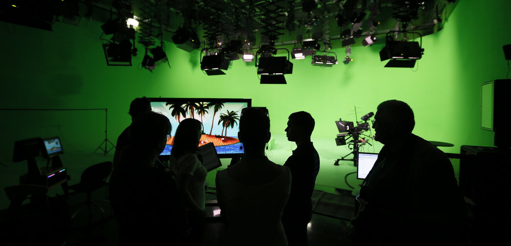 Employees of the Russia Today television channel prepare for a visit b Russian President Vladimir Putin to Russia Today's new headquarters in Moscow, Russia. (Yuri Kochetkov/AP)