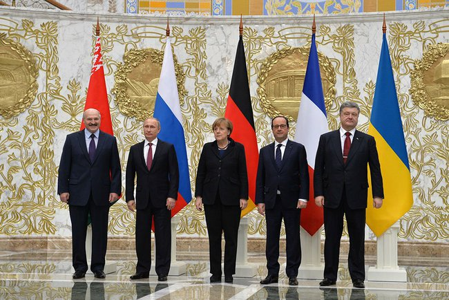 Alexander Lukashenko, Vladimir Putin, Angela Merkel, Francois Hollande, and Petro Poroshenko take part in the talks on a settlement to the situation in Ukraine in Minsk, 2015. (The Russian Presidential Press and Information Office/Wikimedia)