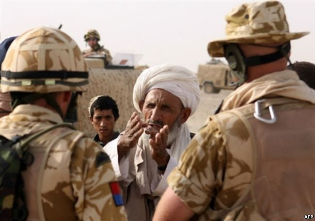 Coalition soldiers meet with local Afghan elders in Helmand Province. (AFP)