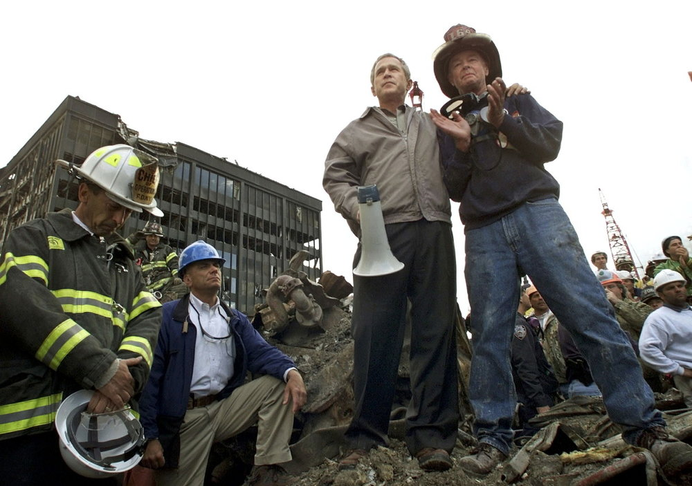President George Bush with first responders in September 2001 (History.com)