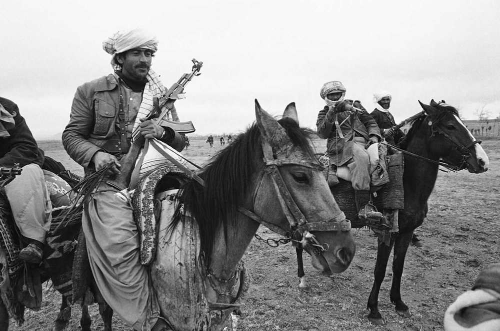 Three Afghan mujahideen, one armed with a Soviet-made AK-47 assault rifle, left, the others with older bolt-action rifles, pose on horseback during a meeting near Herat in 1980. (Rare Historical Photos)