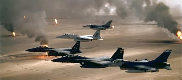 F-15 and F-16 flying over Kuwaiti oil fires during the Gulf War in 1991. (Wikimedia)