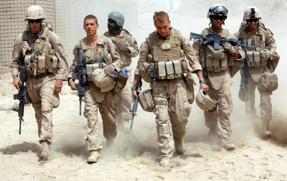 A U.S. Navy corpsman and U.S. Marines in Afghanistan. (Reuters)
