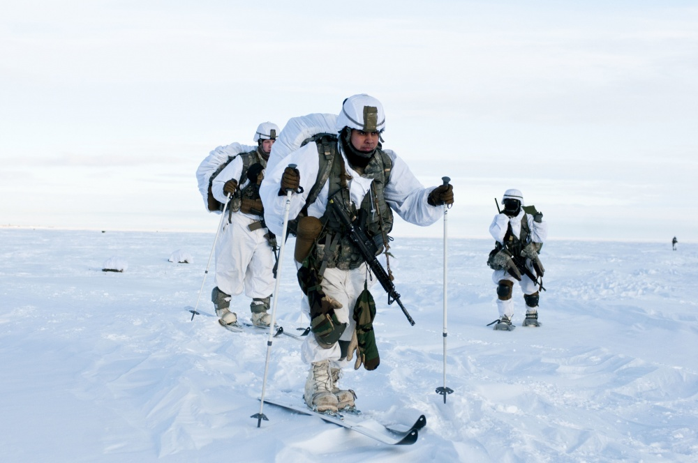 Paratroopers with U.S. Army Alaska's 4th Infantry Brigade Combat Team (Airborne), 25th Infantry Division ski across the drop zone during Exercise Spartan Pegasus. The extremely cold demonstration in airborne operations and arctic mobility took place in one of the northern-most territories of Alaska, well north of the Earth's Arctic Circle. (SSG Daniel Love/U.S. Army Photo)