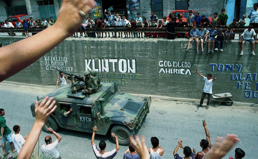 U.S. troops receive a rapturous welcome as they roll into the Kosovar town of Gjilan. (Ami Vitale/Getty Images)