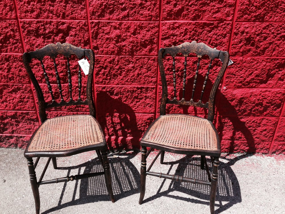 Early 1900's cane seat hand painted spindle back chairs.
