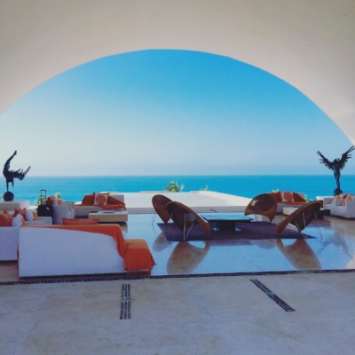 The open air lobby with soaring arches on either side provides an immediate view of the ocean  upon arrival.
