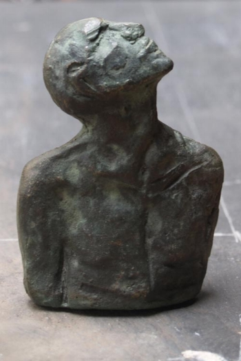 """Lucky"", a small solid bronze sculpture cast in sand"