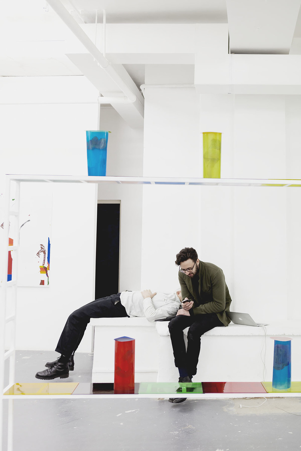 After a long day getting everything ready for the private view, Henry and artist Ben Horns takes a rest before the peoplearrives.