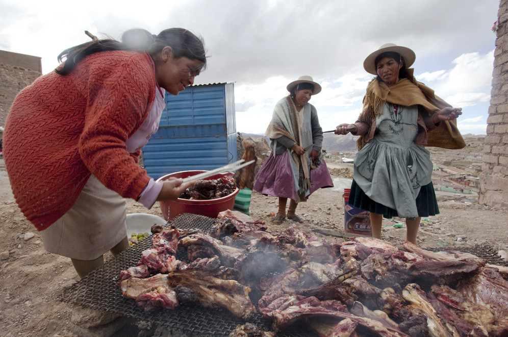 The women cook the llama meat without any spices or salt. Salt is considered bad luck.