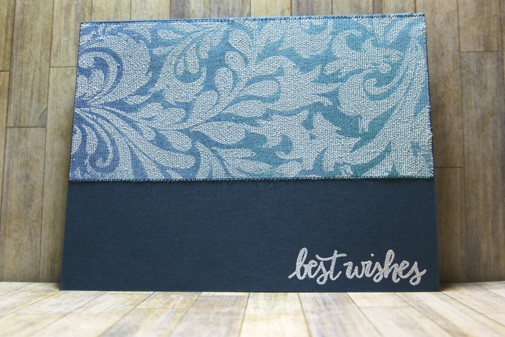Hero Arts background white embossed on sSticky-back canvas then rubbed with Faded Jeans and Peacock Feathers Distress ink. It's mounted on Navy cardstock which is stamped with a Studio Calico white embossed sentiment.