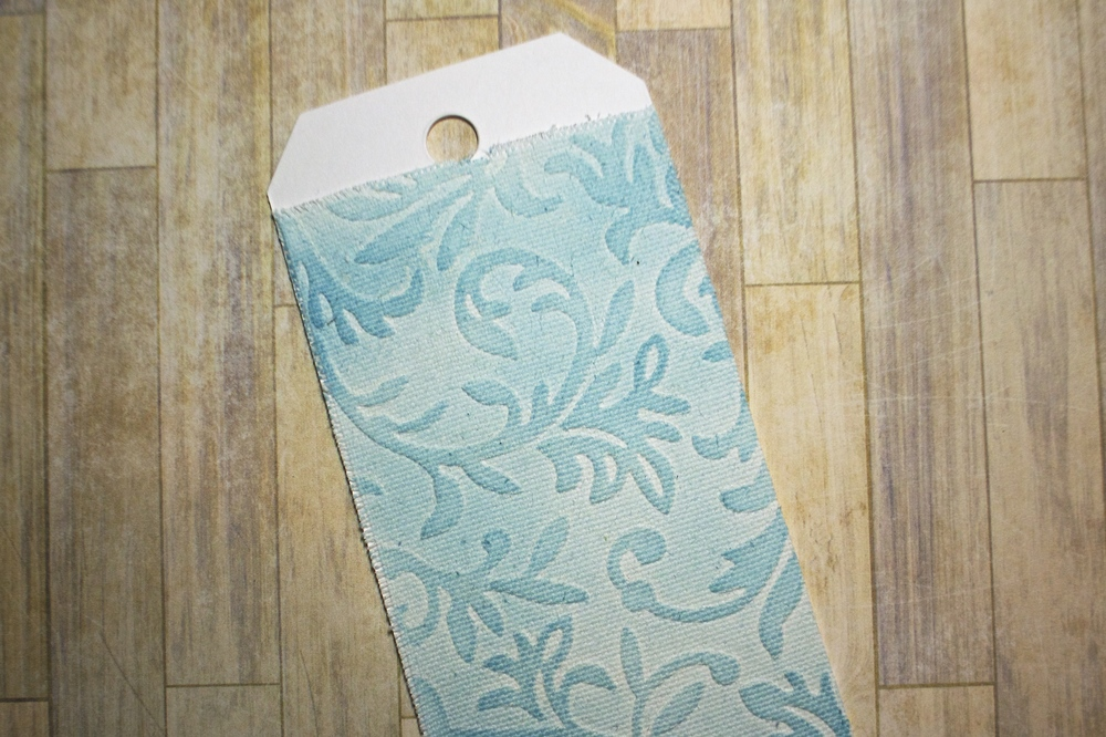 embossed canvas tag