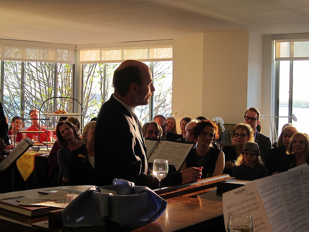 a rapt audience in a private home enjoys a KCO soiree-fundraiser.